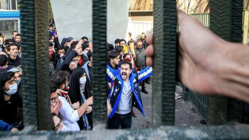 University students attend an anti-government protest inside Tehran University on Dec. 30, 2017.