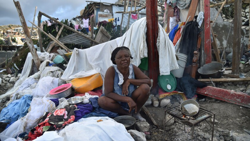A woman sits in her home destroyed by Hurricane Matthew in Jeremie, western Haiti.