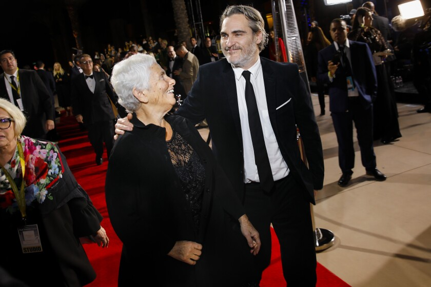 Actor Joaquin Phoenix arrives with his mother, Arlyn, at the Palm Springs International Film Festival Film Awards Gala