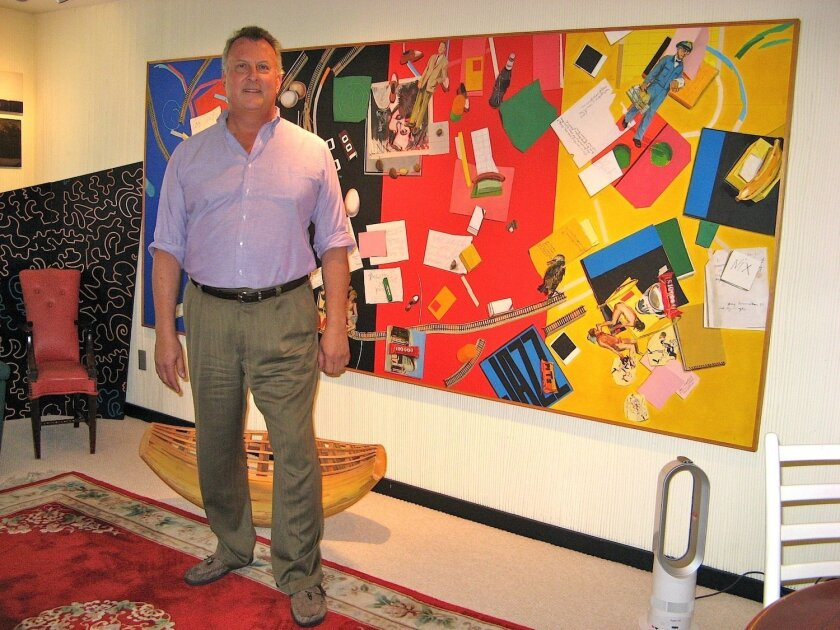Doug Simay, with one of his Manny Farber paintings. 'I was Manny's first collector,' he said. 'And I had to take out a second mortgage on my condo to pay for this one.'