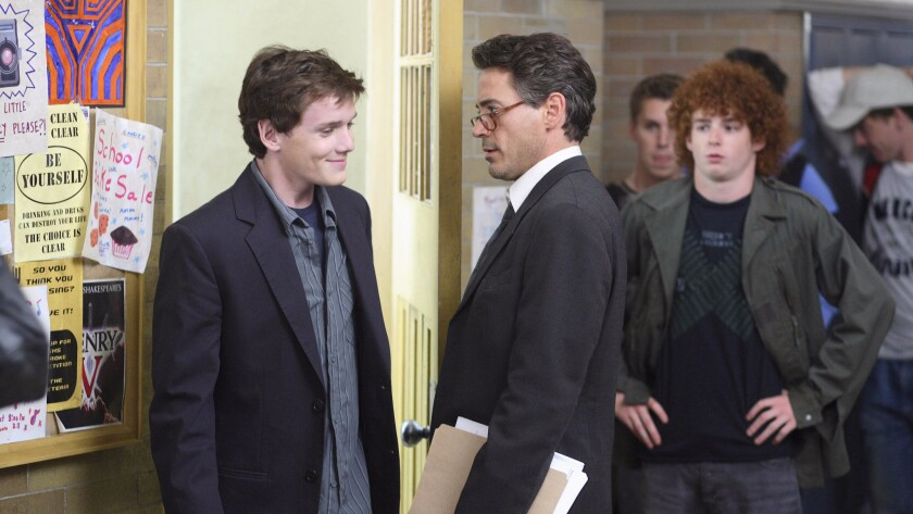 "Anton Yelchin (as Charlie Bartlett) and Robert Downey Jr. (as The Principal) in the 2007 movie ""Charlie Bartlett."""