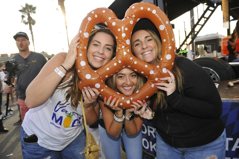 Revelers celebrate Oktoberfest with a twist in Ocean Beach in 2019. This year's OB Oktoberfest event is Oct. 8-9.