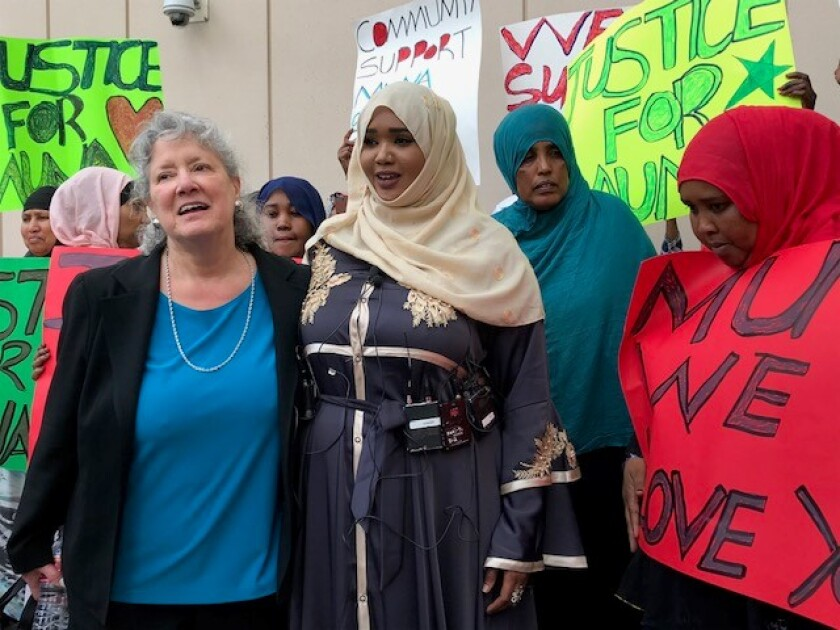 Muna Kuri's sister, Amiina Salad, in light scarf, spoke after court Tuesday, saying her brother-in-law has expressed no remorse for killing his wife.