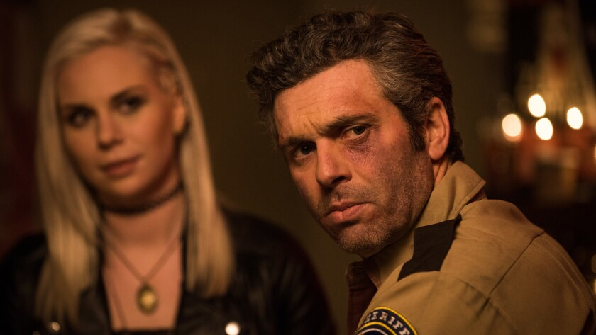 """Serena Miller and Leo Fafard in a scene from the movie """"Another Wolf Cop."""""""