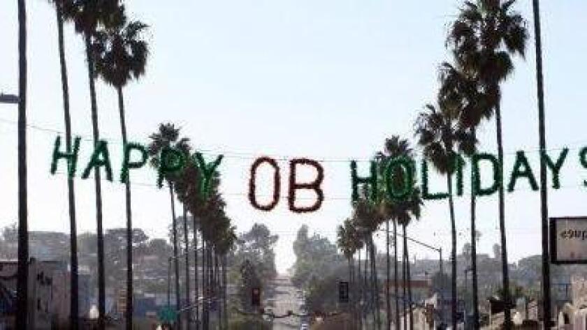 Ocean Beach Holiday sign hangs above Newport Ave. (Ocean Beach Mainstreet Association)