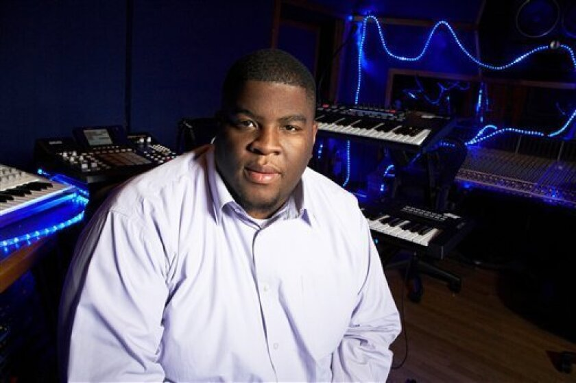 This Jan. 29, 2013 photo shows Grammy-nominated producer Salaam Remi posing for a portrait at his studio in New York. Remi, best known for his work with Amy Winehouse and Nas, is nominated for non-classical producer of the year at Sunday's Grammy Awards. Last year, his production credits include so