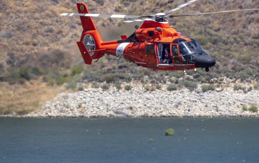 A Coast Guard helicopter assisting in the search for Naya Rivera flies over Lake Piru on Thursday.