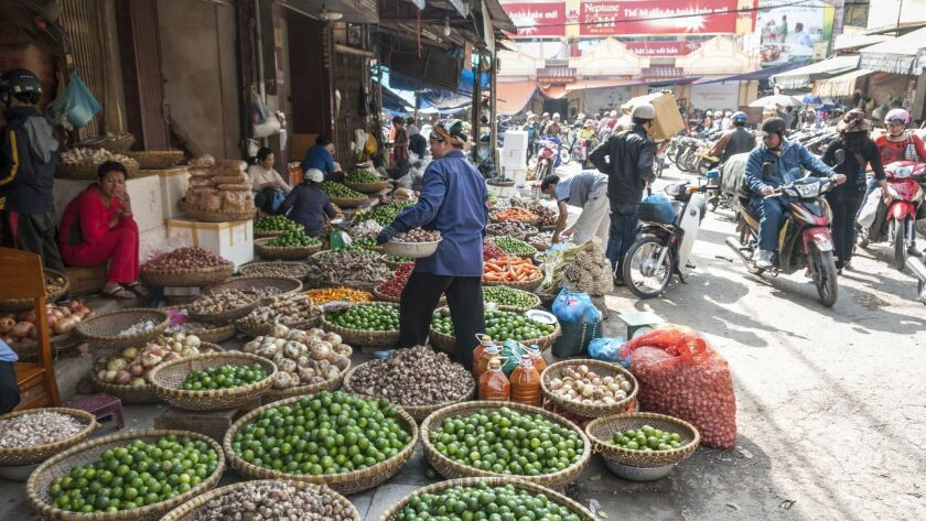Market vendors in Hanoi, one of two Vietnam destinations in a nine-day travel package deal offered by World Spree, starting at $999, including round-trip airfare.