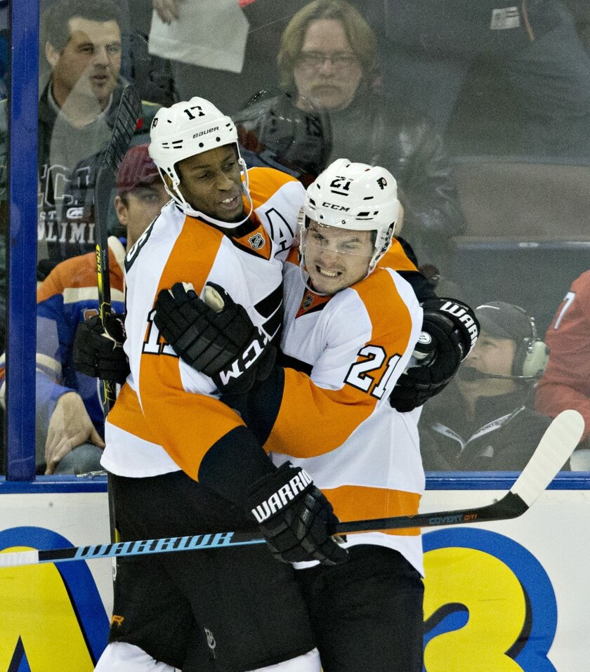 Philadelphia Flyers' Wayne Simmonds (17), left, and teammate Scott Laughton (21) celebrate a goal against the Edmonton Oilers during the second period of an NHL hockey game in Edmonton, Alberta, Tuesday, Nov. 3, 2015. (Jason Franson/The Canadian Press via AP) MANDATORY CREDIT