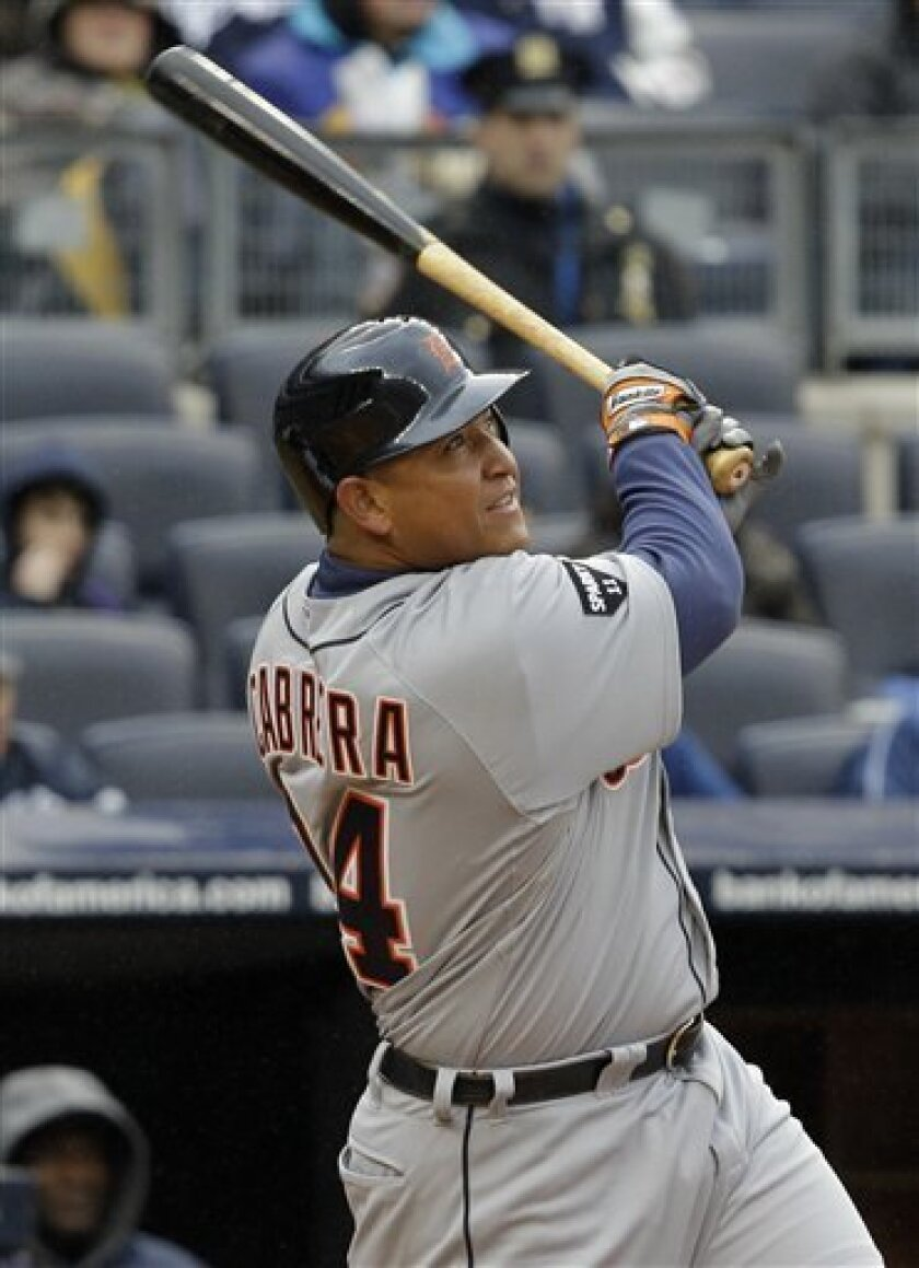 Detroit Tigers Miguel Cabrera watches his sixth-inning sacrifice fly off New York Yankees starting pitcher CC Sabathia in their opening day baseball game at Yankee Stadium on Thursday, March 31, 2011 in New York. (AP Photo/Kathy Willens)