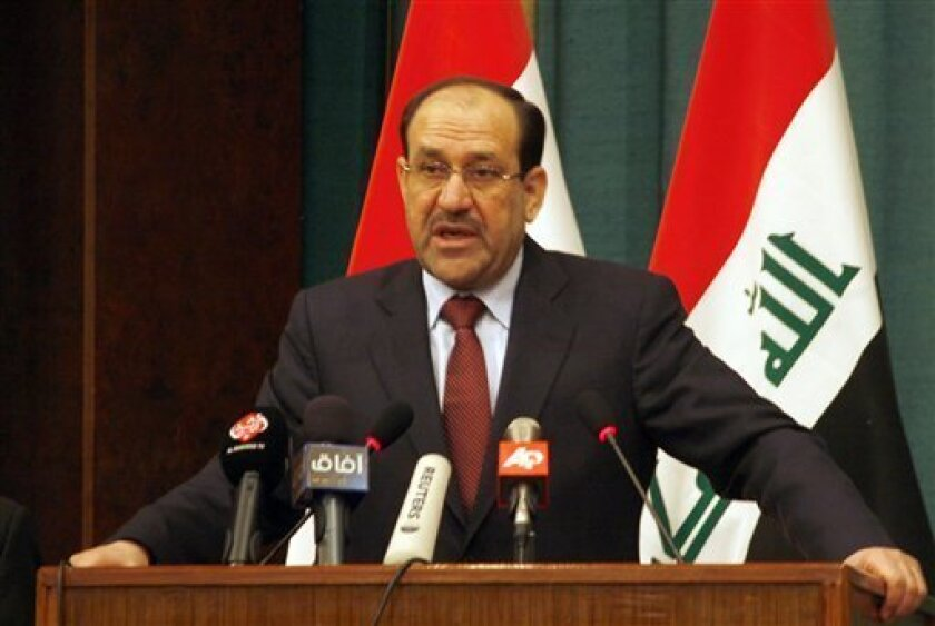 Iraqi Prime Minister Nouri al-Maliki addresses Iraqi tribal members and leaders at a conference of southeast Baghdad's tribes at the al-Rashid hotel in Baghdad, Iraq Sunday, Jan. 18, 2009.  (AP Photo/Mohammed Jalil, Pool)