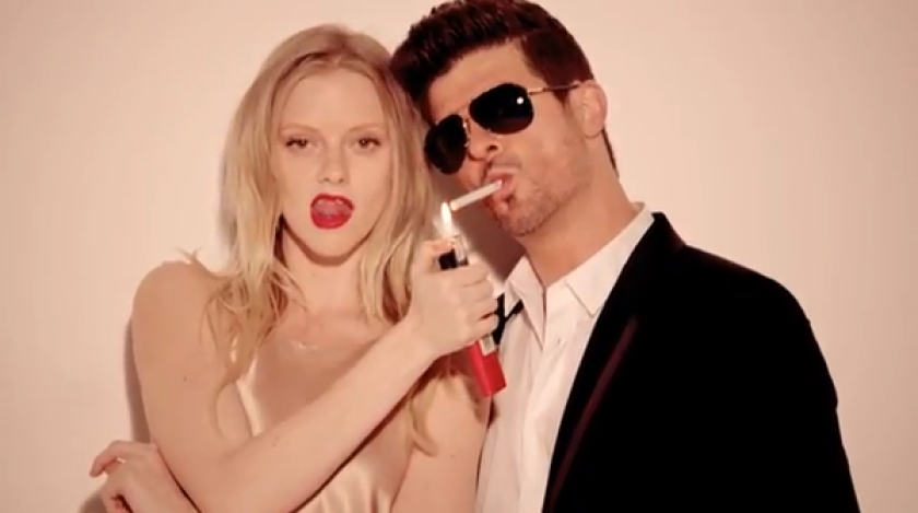 "Robin Thicke's record label said his song ""Blurred Lines"" has reached a record number of radio listeners."