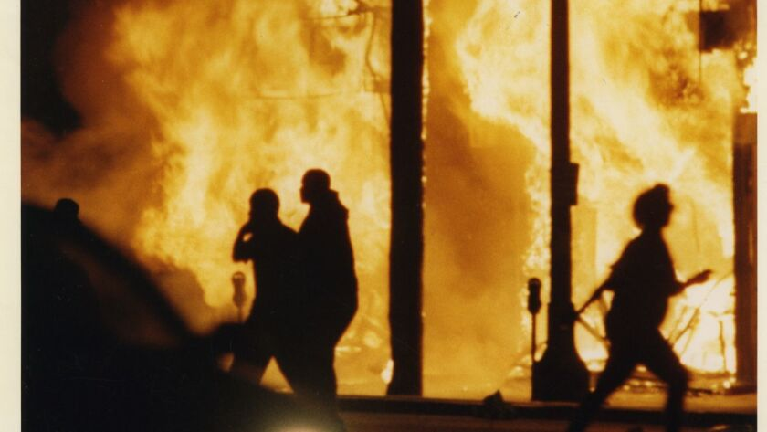 April 29, 1992: Flames engulf a row of businesses at Vermont and Manchester during the Los Angeles R