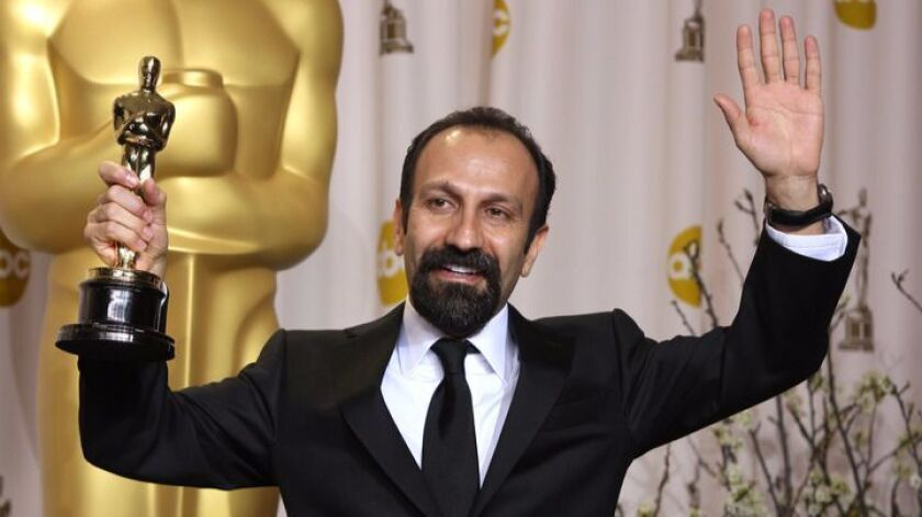 """Iranian filmmaker Asghar Farhadi accepts the 2012 Academy Award for best foreign language film for """"A Separation."""""""