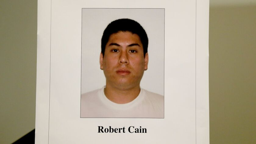 Photo of Officer Robert Cain on display at an LAPD news conference, where Los Angeles Police Chief Charlie Beck announced Cain was under arrest on suspicion of statutory rape of a 15-year-old cadet.