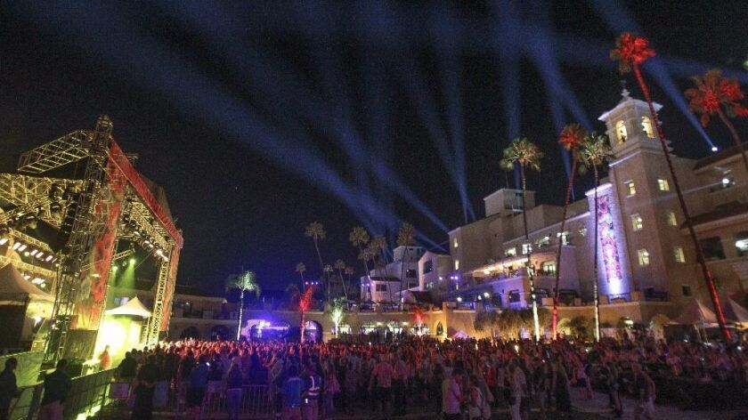 KAABOO Del Mar lights up the night and the Grandstand at the Del Mar racetrack.