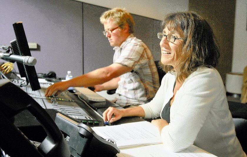 """Levine and engineer/editor Tim Felten work in the control room at the Rancho Bernardo sound studio during a weekly taping of """"A Way With Words,"""" which is broadcast by 52 public-radio affiliates."""