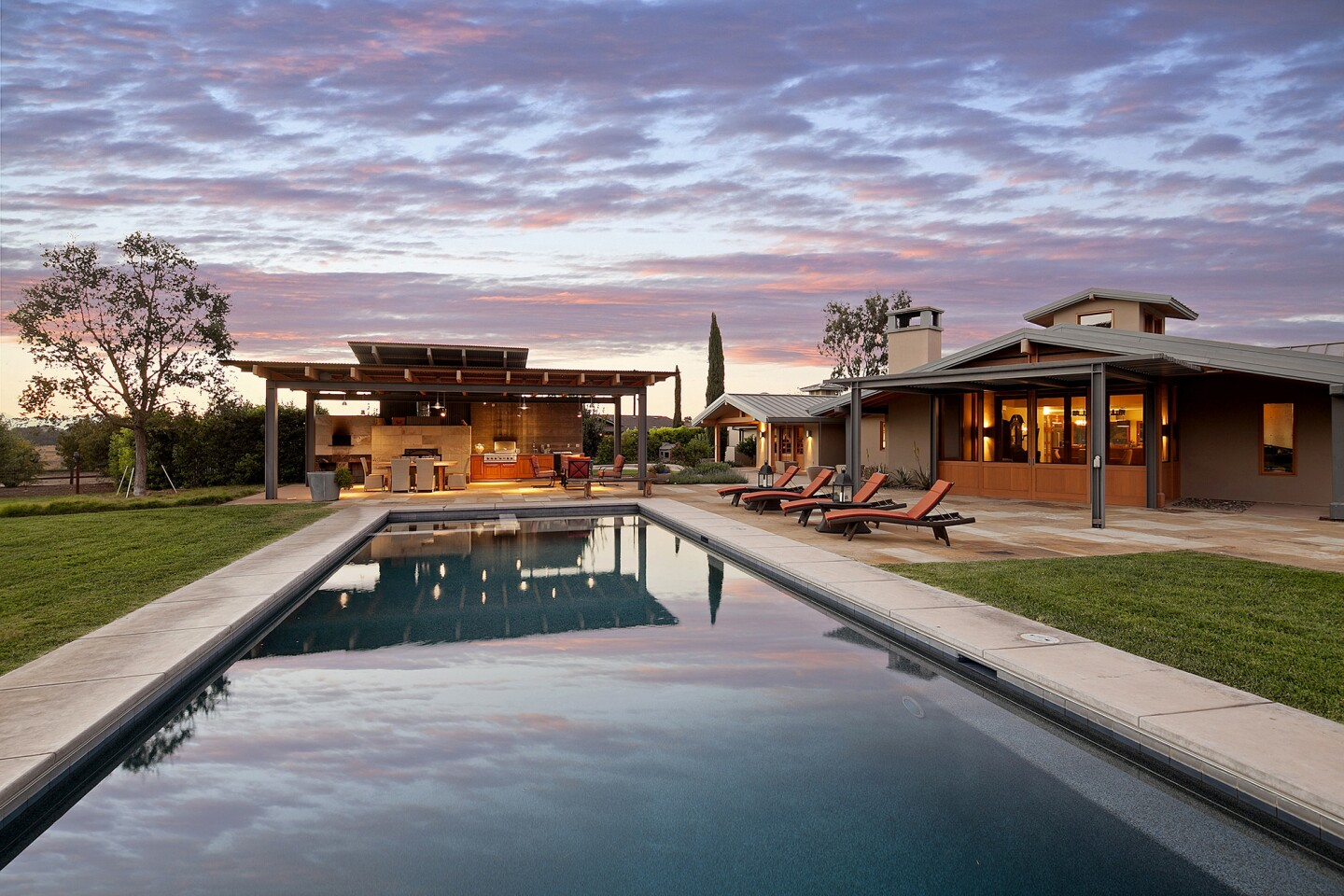 Actress-singer Olivia Newton-John is asking $5.4 million for her Santa Ynez Valle ranch, which features two homes, a swimming pool and a smattering of equestrian facilities. The main house features a cathedral-like great room topped with skylights and exposed beams. The open-plan space adjoins the kitchen.