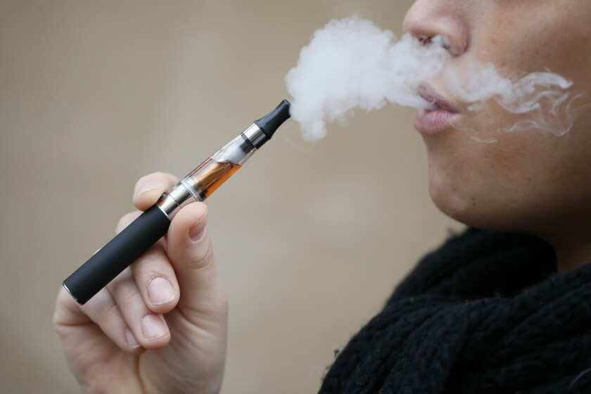 An e-cigarette smoker in Paris.
