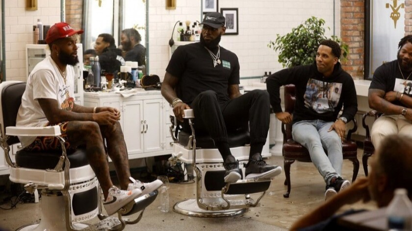"NBA star LeBron James, center, hosts HBO's ""The Shop,"" with guests including Odell Beckham Jr., from left, Maverick Carter and Michael Bennett."