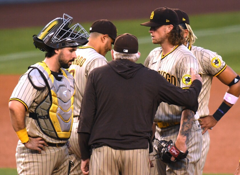 Padres starter Chris Paddack gets a visit from pitching coach Larry Rothschild during the third inning Thursday night.