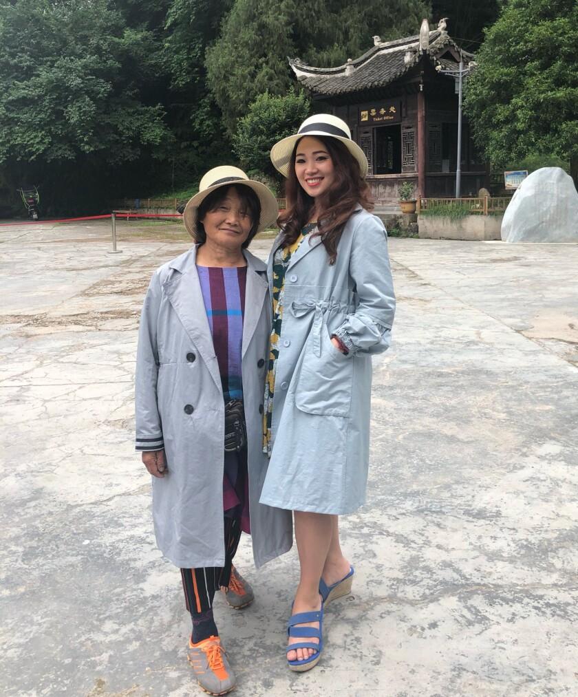 Zhou Guangtao and daughter Tami Xiang