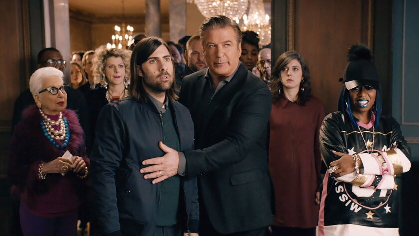 A scene from Amazon's spot for Super Bowl 50, with Jason Schwartzman, Alec Baldwin, center right, and Missy Elliott, right.