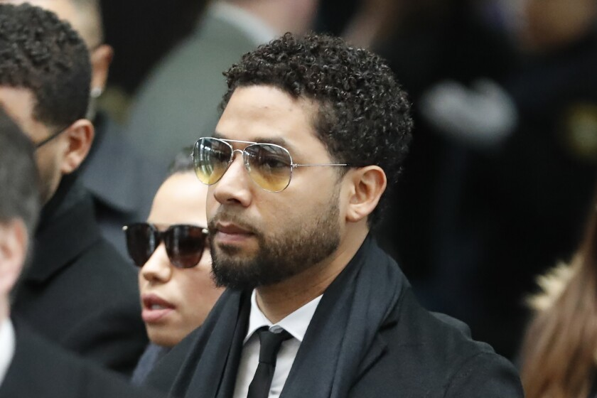 """Former """"Empire"""" actor Jussie Smollett, center, arrives for an initial court appearance at the Leighton Criminal Courthouse in Chicago."""