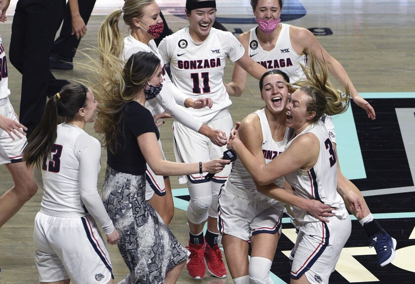 Gonzaga celebrates a victory over BYU in an NCAA college basketball game for the West Coast Conference women's tournament championship Tuesday, March 9, 2021, in Las Vegas. (AP Photo/David Becker)
