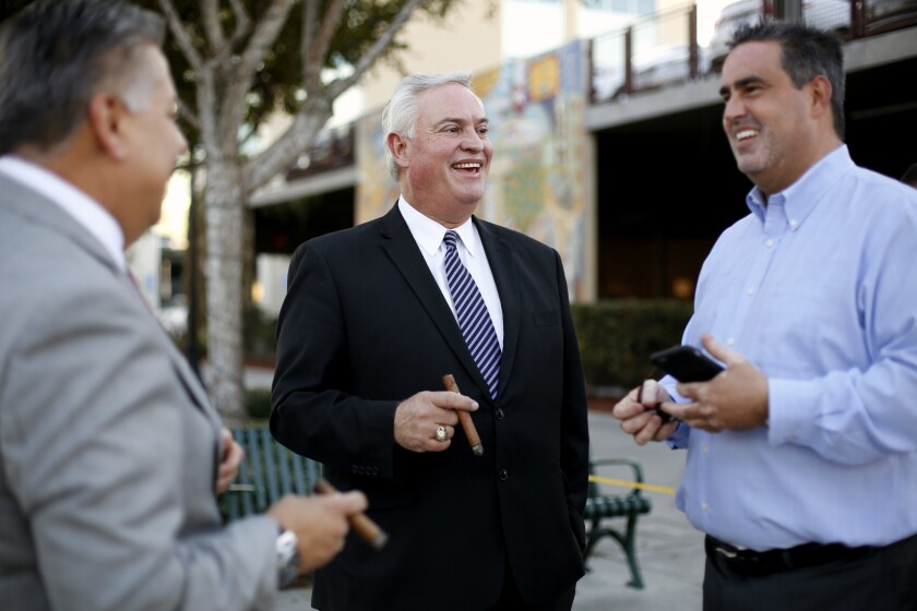 Mario Guerra, center, former mayor of Downey and treasurer of the California Republican party, with Rick Rodriguez, left, a council member-elect, and Alex Saab, mayor of Downey, in Downey.