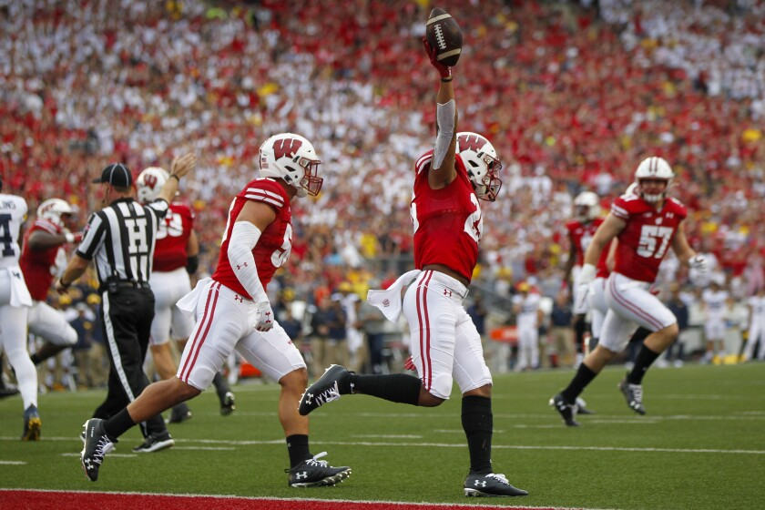 Wisconsin running back Jonathan Taylor celebrates a touchdown against Michigan on Saturday in Madison, Wis.