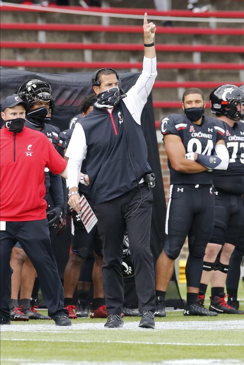Cincinnati head coach Luke Fickell instructs his team against Army during the first half of an NCAA college football game Saturday, Sept. 26, 2020, in Cincinnati, Ohio. Cincinnati beat Army 24-10. (AP Photo/Jay LaPrete)