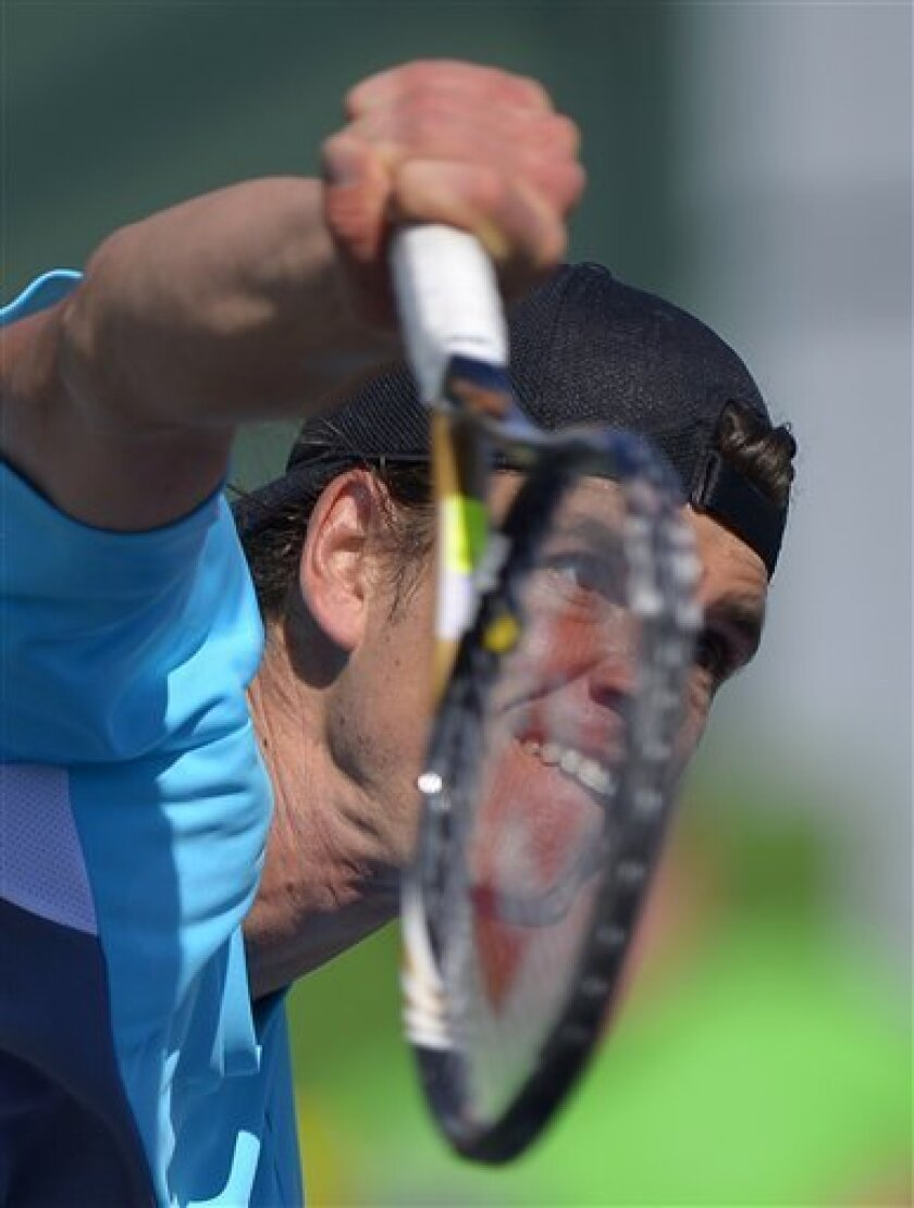 Frank Dancevic, of Canada, serves to Matthew Ebden, of Australia, during their match at the BNP Paribas Open tennis tournament on Wednesday, March 6, 2013, in Indian Wells, Calif. (AP Photo/Mark J. Terrill)