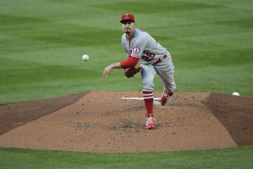 Angels starting pitcher Andrew Heaney throws to a Seattle Mariners batter.
