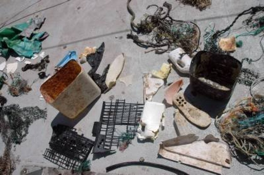 An array of plastic, ghost nets and other pieces of marine debris collected during SEAPLEX voyage in 2009 on the deck of New Horizon research vessel.