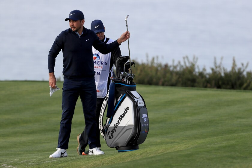 Jason Day draws a club during the pro-am tournament at the Farmers Insurance Open in San Diego on Wednesday.