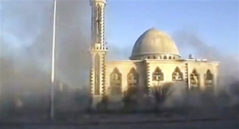 This image from amateur video made available by Shaam News Network on Thursday, Feb. 9, 2012, purports to show smoke filling the air near a mosque in Homs, Syria. (AP Photo/Shaam News Network via APTN) THE ASSOCIATED PRESS CANNOT INDEPENDENTLY VERIFY THE CONTENT, DATE, LOCATION OR AUTHENTICITY OF THIS MATERIAL. TV OUT