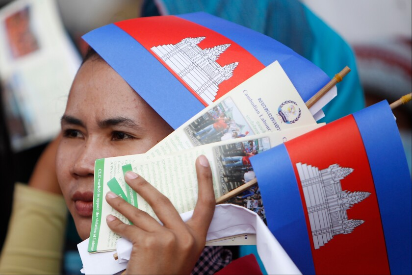 FILE - In this May 1, 2018, file photo, a worker participates during a gathering to mark May Day at Tonle Sap river bank, in Phnom Penh, Cambodia. Cambodia's government announced Friday it is raising the minimum wage for the garment industry, the country's biggest export earner, whose workers make up a powerful political bloc. (AP Photo/Heng Sinith, File)