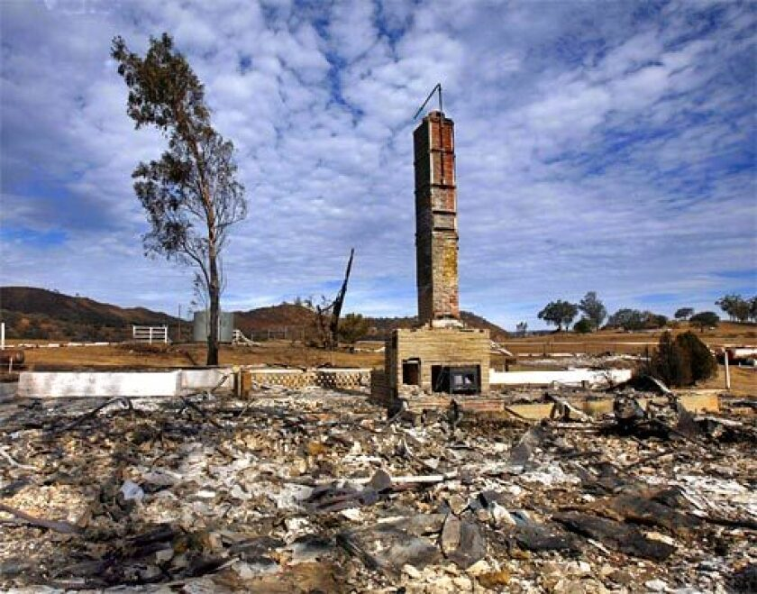 Only a chimney remains standing at the site of a home destroyed in the 2007 Witch Creek fire in San Diego County.