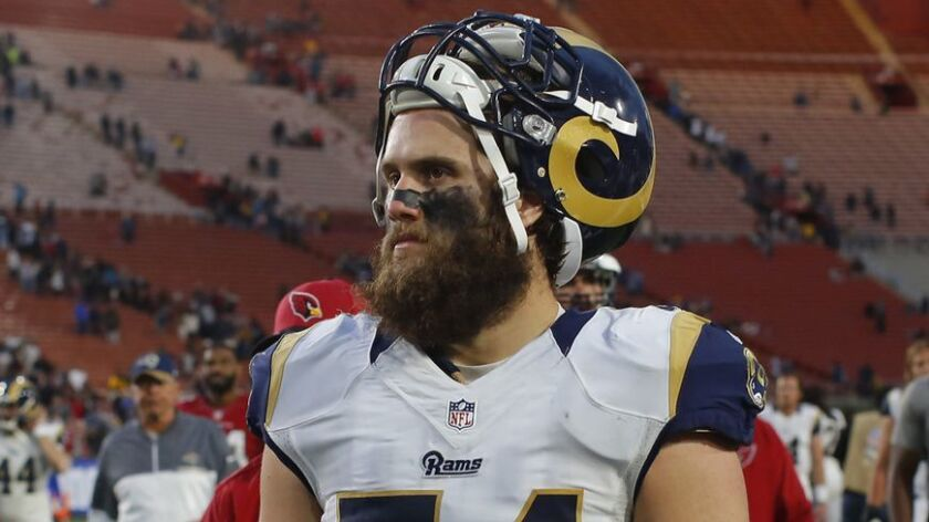 Rams linebacker Bryce Hager leaves the Coliseum field after a game.