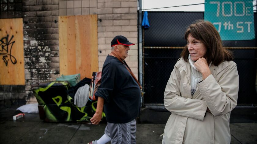 Lisa Rich stands outside her fire-damaged property on East 7th Street. A December blaze engulfed a tent on skid row and spread to her warehouse.