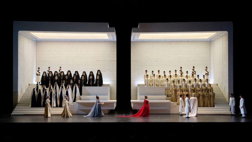 "Anna Netrebko (blue gown) as Aida and Ekaterina Semenchuk (red gown) as Amneris in Verdi ""Aida,"" staged by Shirin Neshat, at Austria's Salzburg Festival"