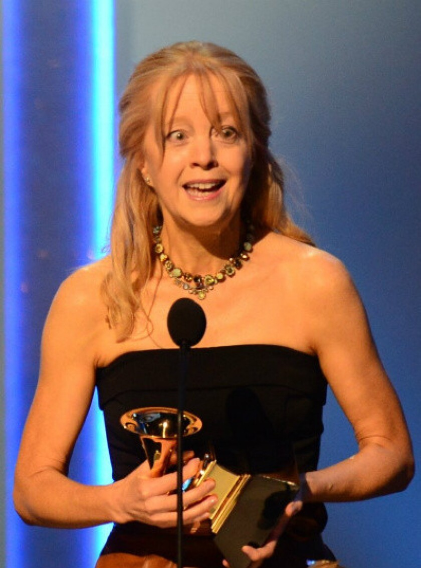 """Maria Schneider accepts her Grammy Award for contemporary classical composition for """"Winter Morning Walks"""" at the Nokia Theatre in Los Angeles."""