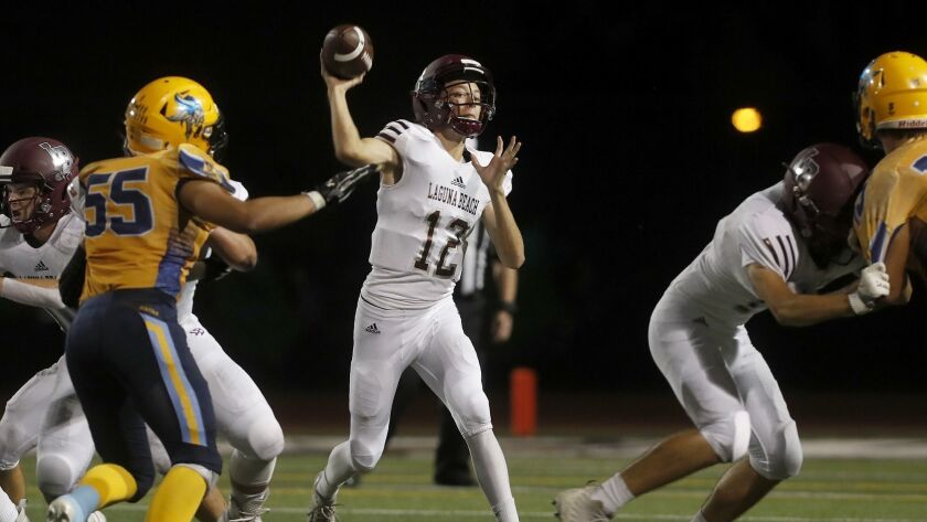 Laguna Beach High quarterback Andrew Johnson (12) throws against Marina during the first half in a n
