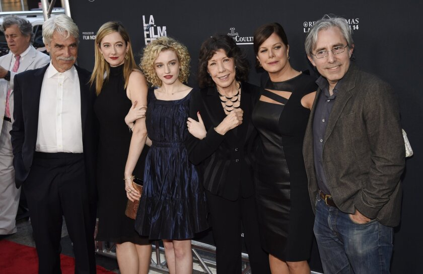 """Paul Weitz, far right, writer-director of """"Grandma,"""" poses with cast members (left to right) Sam Elliott, Judy Greer, Julia Garner, Lily Tomlin and Marcia Gay Harden at the premiere of the film on the opening night of the Los Angeles Film Festival on Wednesday at LA Live."""