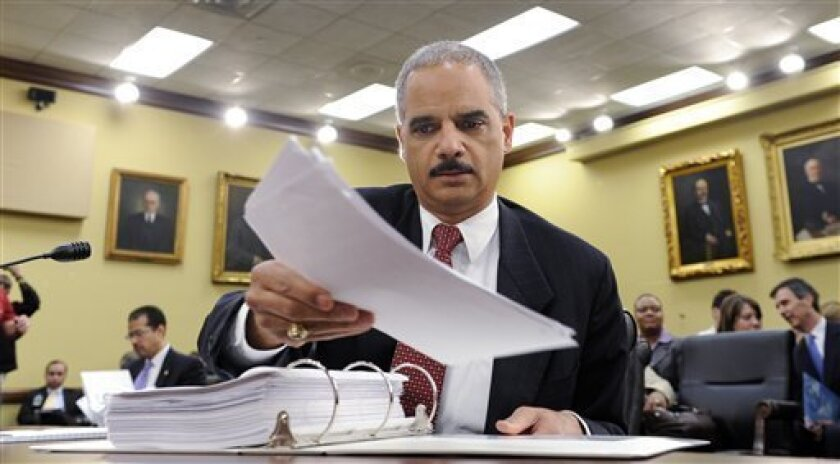 FILE - In this April 23, 2009 file photo Attorney General Eric Holder prepares to testify before the House Appropriations Committee on Capitol Hill in Washington. Justice Department officials have stopped short of recommending criminal charges against Bush administration lawyers who wrote secret memos approving harsh interrogation techniques of terror suspects. (AP Photo/Susan Walsh, File)