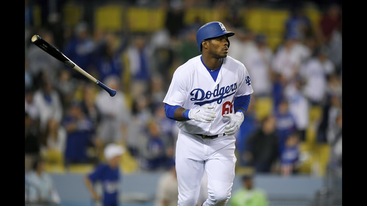 Dodgers right fielder Yasiel Puig tosses his bat after hitting a solo home run during the ninth inning of a game against the Phillies at Dodger Stadium on April 29.