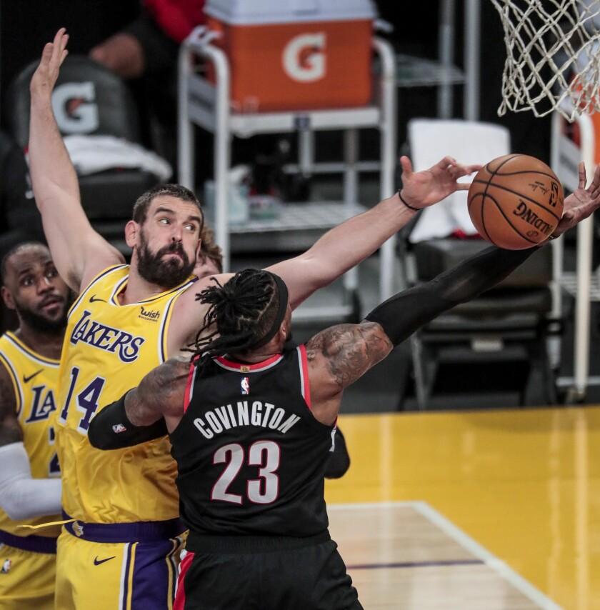 Lakers center Marc Gasol blocks a layup by Trail Blazers forward Robert Covington.