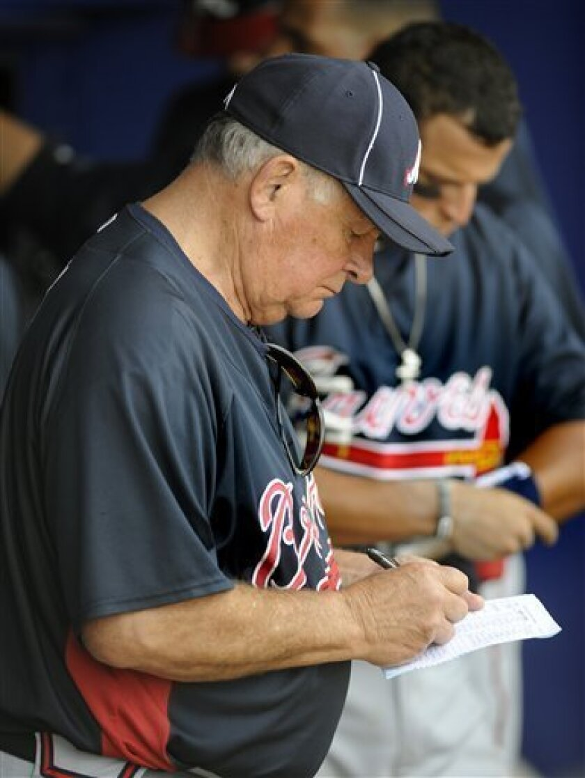 Atlanta Braves manager Bobby Cox checks his lineup card during a spring training baseball game against the New York Mets Tuesday, March 2, 2010 in Port St. Lucie, Fla. (AP Photo/Rick Silva)
