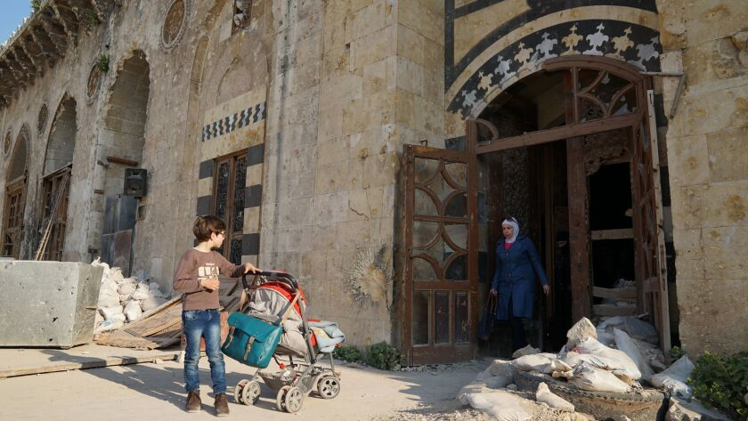 The entrance of Aleppo's historic Umayyad mosque, in the historic Old City, bears scars from fighti
